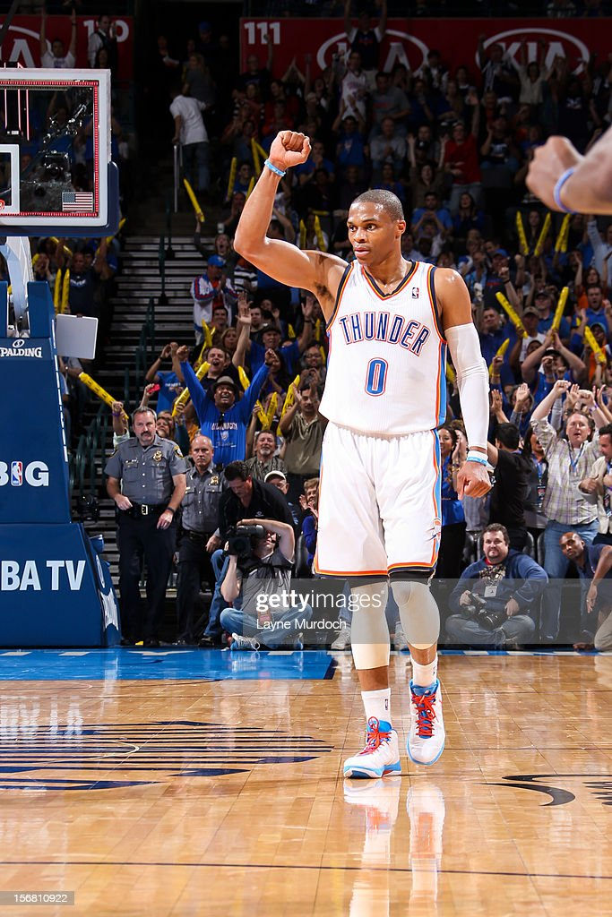 Russell Westbrook #0 of the Oklahoma City Thunder celebrates after teammate Serge Ibaka #9 made a three-pointer at the quarter buzzer against the Los Angeles Clippers on November 21, 2012 at the Chesapeake Energy Arena in Oklahoma City, Oklahoma.
