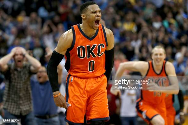 Russell Westbrook of the Oklahoma City Thunder celebrates after scoring a gamewinning threepoint shot at the buzzer against the Denver Nuggets at...
