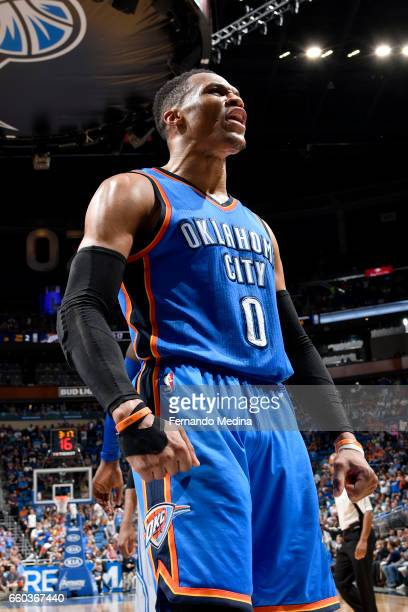 Russell Westbrook of the Oklahoma City Thunder celebrates after scoring against the Orlando Magic on March 29 2017 at Amway Center in Orlando Florida...