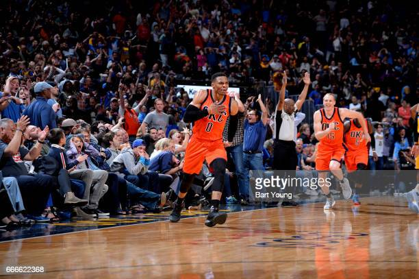 Russell Westbrook of the Oklahoma City Thunder celebrates after hitting the game winning shot against the Denver Nuggets on April 9 2017 at the Pepsi...