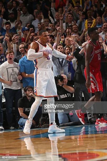 Russell Westbrook of the Oklahoma City Thunder celebrates and pounds his chest after dunking the ball against the Houston Rockets on November 16 2016...