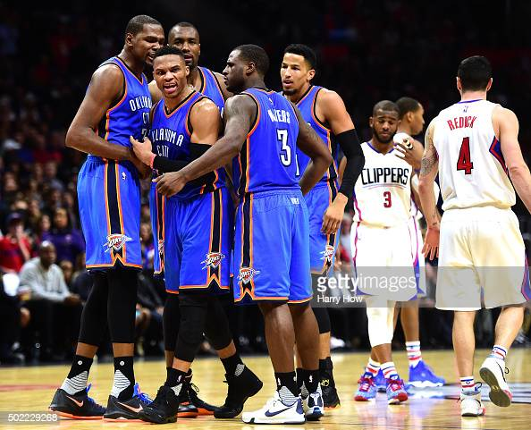 Russell Westbrook of the Oklahoma City Thunder celebrates his defense on JJ Redick of the Los Angeles Clippers with Kevin Durant Serge Ibaka and Dion...