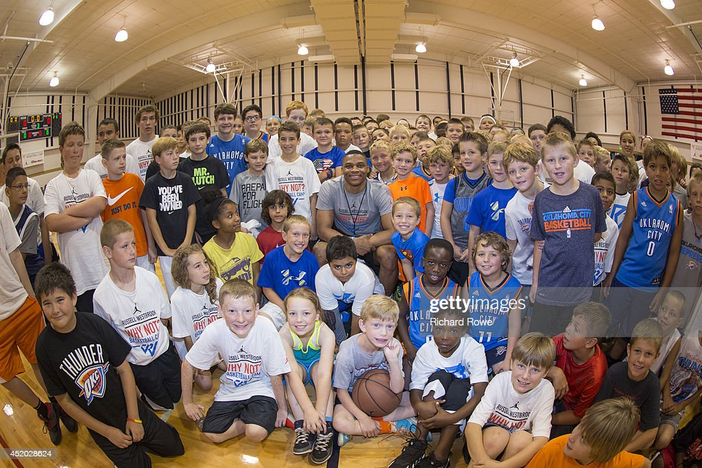 <a gi-track='captionPersonalityLinkClicked' href=/galleries/search?phrase=Russell+Westbrook&family=editorial&specificpeople=4044231 ng-click='$event.stopPropagation()'>Russell Westbrook</a> #0 of the Oklahoma City Thunder coaches children at basketball camp at Heritage Hall on July 10, 2014 in Oklahoma City, Oklahoma.