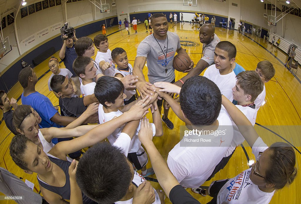 Russell Westbrook #0 of the Oklahoma City Thunder coaches children at basketball camp at Heritage Hall on July 10, 2014 in Oklahoma City, Oklahoma.