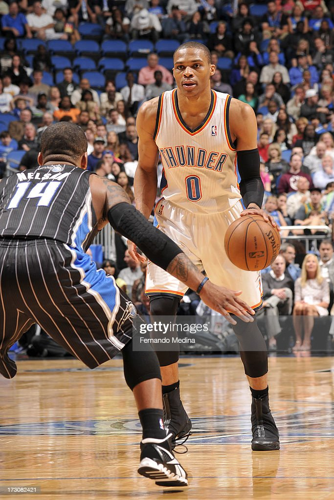 Russell Westbrook #0 of the Oklahoma City Thunder controls the ball against Jameer Nelson #14 of the Orlando Magic on March 22, 2013 at Amway Center in Orlando, Florida.