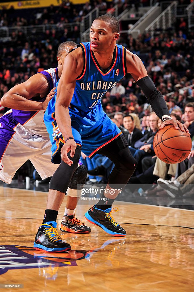 Russell Westbrook #0 of the Oklahoma City Thunder controls the ball against the Phoenix Suns on January 14, 2013 at U.S. Airways Center in Phoenix, Arizona.