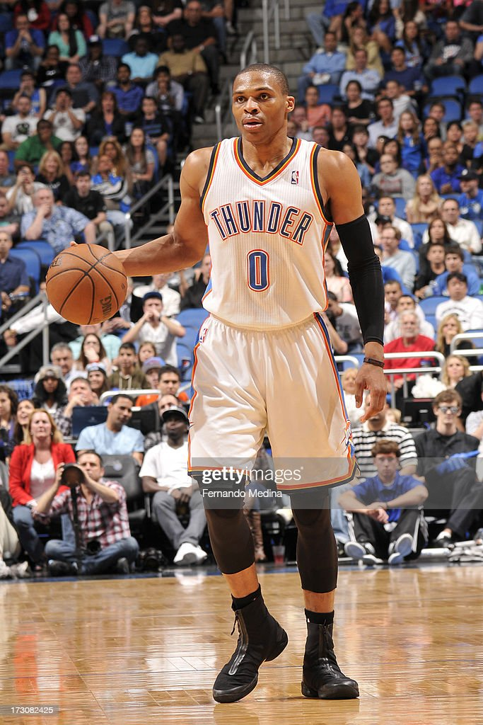 <a gi-track='captionPersonalityLinkClicked' href=/galleries/search?phrase=Russell+Westbrook&family=editorial&specificpeople=4044231 ng-click='$event.stopPropagation()'>Russell Westbrook</a> #0 of the Oklahoma City Thunder controls the ball against the Orlando Magic on March 22, 2013 at Amway Center in Orlando, Florida.