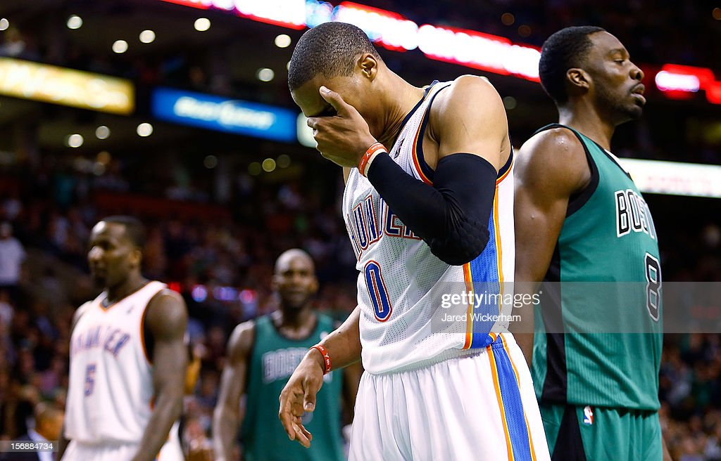 Russell Westbrook #0 of the Oklahoma City Thunder covers his face after getting hit in the head against the Boston Celtics during the game on November 23, 2012 at TD Garden in Boston, Massachusetts.