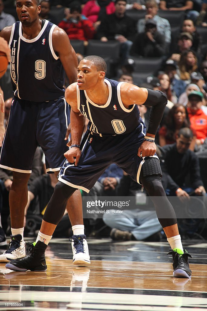 <a gi-track='captionPersonalityLinkClicked' href=/galleries/search?phrase=Russell+Westbrook&family=editorial&specificpeople=4044231 ng-click='$event.stopPropagation()'>Russell Westbrook</a> #0 of the Oklahoma City Thunder defends against the Brooklyn Nets on December 4, 2012 at the Barclays Center in the Brooklyn Borough of New York City.