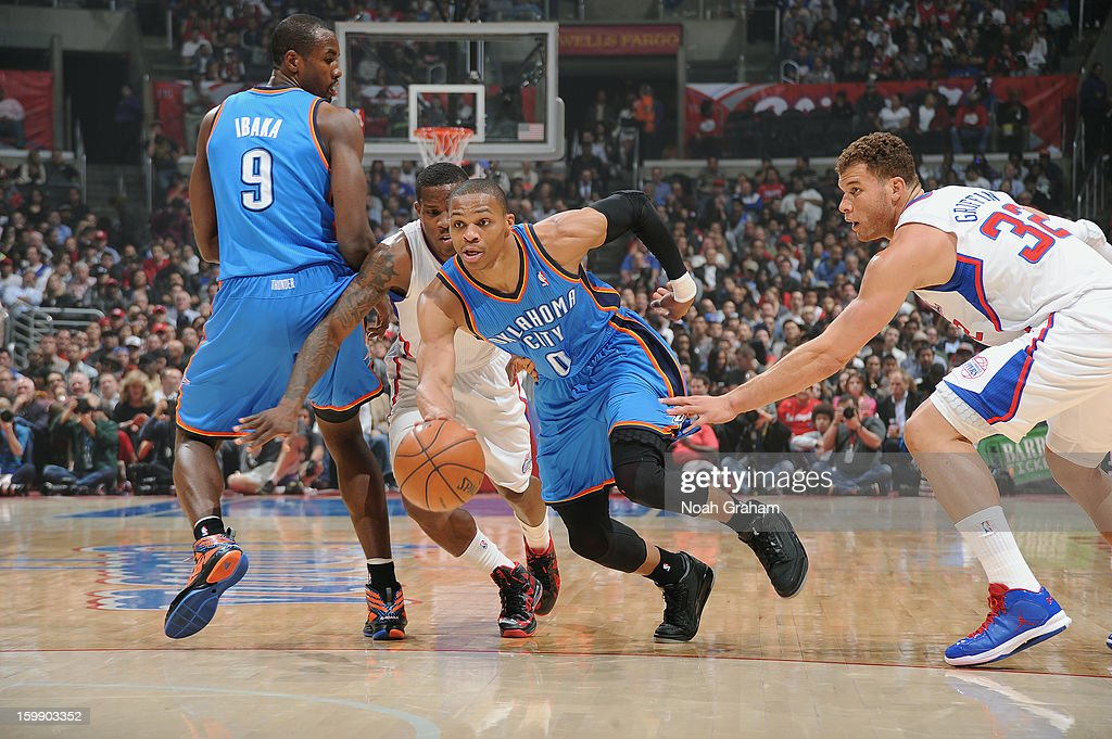 Russell Westbrook #0 of the Oklahoma City Thunder dribbles past Blake Griffin #32 of the Los Angeles Clippers at Staples Center on January 22, 2013 in Los Angeles, California.