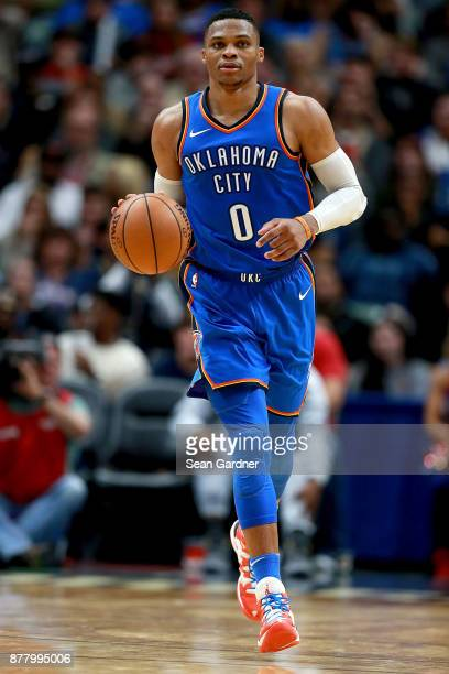 Russell Westbrook of the Oklahoma City Thunder dribbles the ball down court during a NBA game against the New Orleans Pelicans at the Smoothie King...