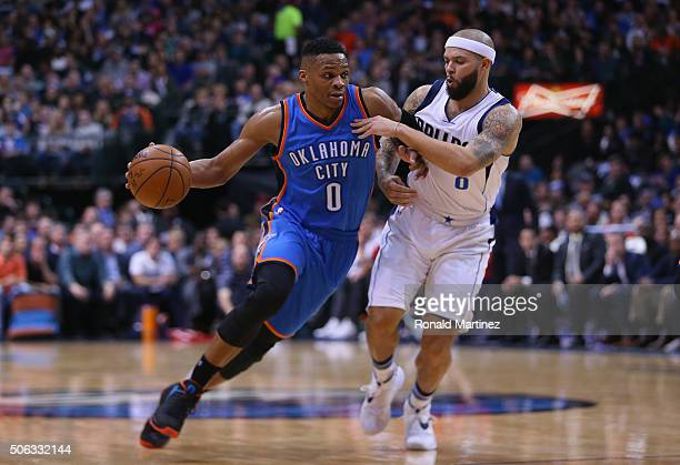Russell Westbrook of the Oklahoma City Thunder dribbles the ball against Deron Williams of the Dallas Mavericks in the first half at American...