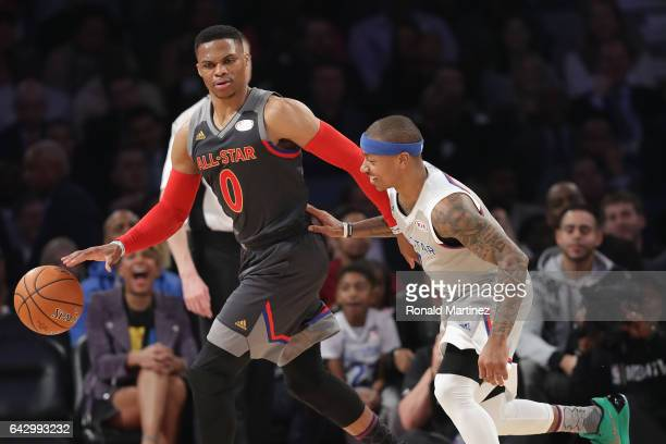 Russell Westbrook of the Oklahoma City Thunder dribbles the ball against Isaiah Thomas of the Boston Celtics in the first half of the 2017 NBA...