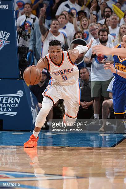 Russell Westbrook of the Oklahoma City Thunder dribbles the ball up court against the Golden State Warriors in Game Four of the Western Conference...