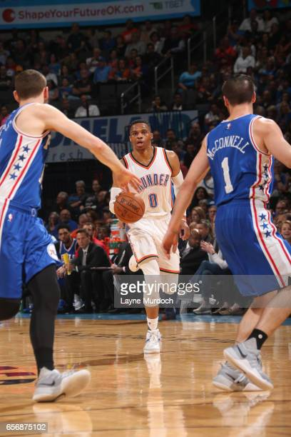 Russell Westbrook of the Oklahoma City Thunder dribbles the ball up court en route to the first ever perfect triple double in NBA history during the...
