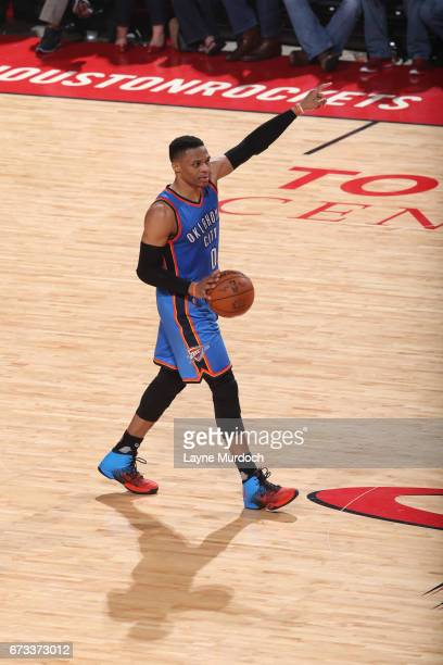 Russell Westbrook of the Oklahoma City Thunder dribbles the ball up court against the Houston Rockets in Game Five of the Western Conference...