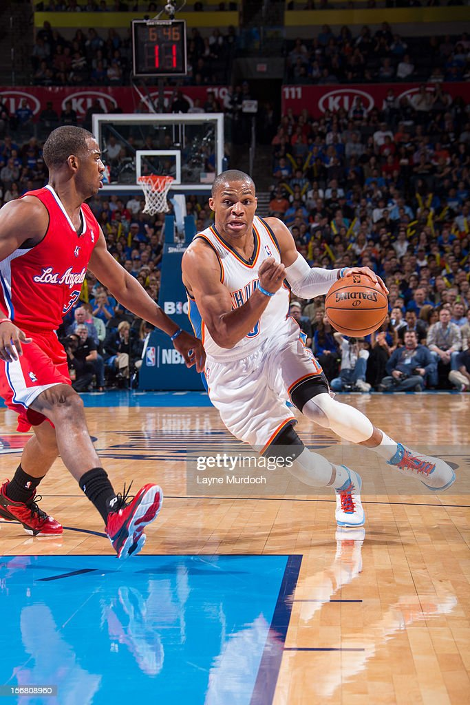 Russell Westbrook #0 of the Oklahoma City Thunder drives against Chris Paul #3 of the Los Angeles Clippers on November 21, 2012 at the Chesapeake Energy Arena in Oklahoma City, Oklahoma.