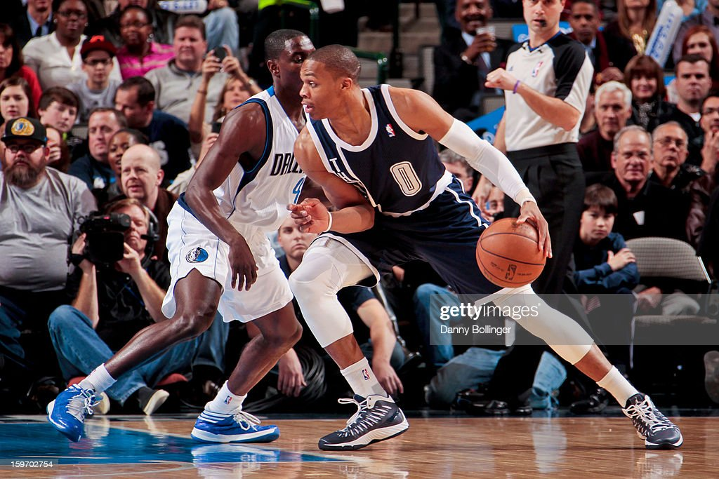 Russell Westbrook #0 of the Oklahoma City Thunder drives against Darren Collison #4 of the Dallas Mavericks on January 18, 2013 at the American Airlines Center in Dallas, Texas.