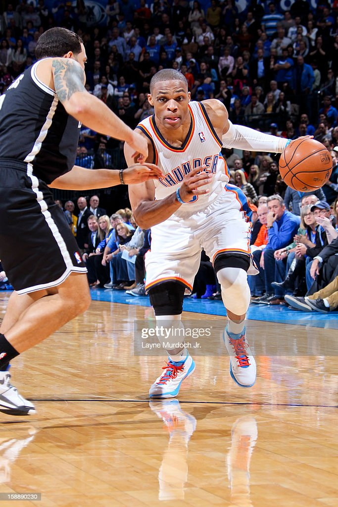 <a gi-track='captionPersonalityLinkClicked' href=/galleries/search?phrase=Russell+Westbrook&family=editorial&specificpeople=4044231 ng-click='$event.stopPropagation()'>Russell Westbrook</a> #0 of the Oklahoma City Thunder drives against <a gi-track='captionPersonalityLinkClicked' href=/galleries/search?phrase=Deron+Williams&family=editorial&specificpeople=203215 ng-click='$event.stopPropagation()'>Deron Williams</a> #8 of the Brooklyn Nets on January 2, 2013 at the Chesapeake Energy Arena in Oklahoma City, Oklahoma.
