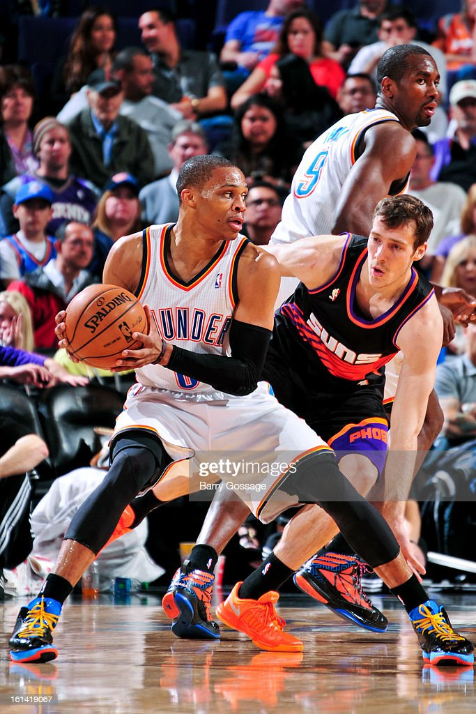 Russell Westbrook #0 of the Oklahoma City Thunder drives against Goran Dragic #1 of the Phoenix Suns on February 10, 2013 at U.S. Airways Center in Phoenix, Arizona.