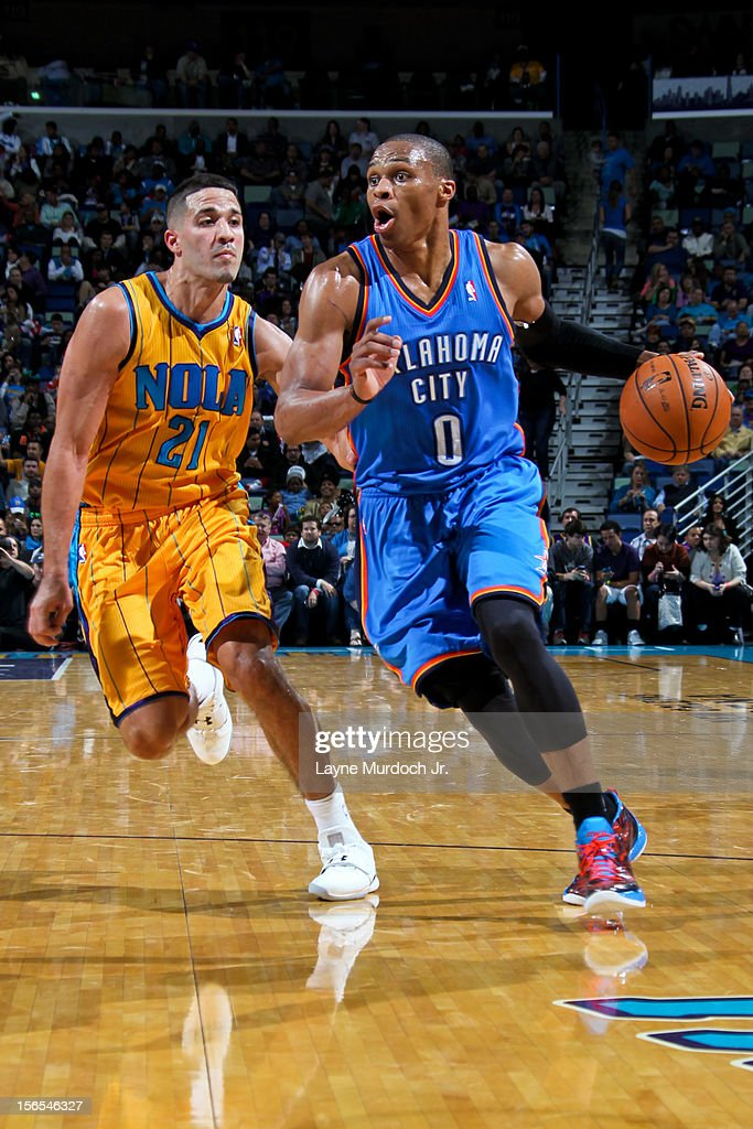 Russell Westbrook #0 of the Oklahoma City Thunder drives against Greivis Vasquez #21 of the New Orleans Hornets on November 16, 2012 at the New Orleans Arena in New Orleans, Louisiana.