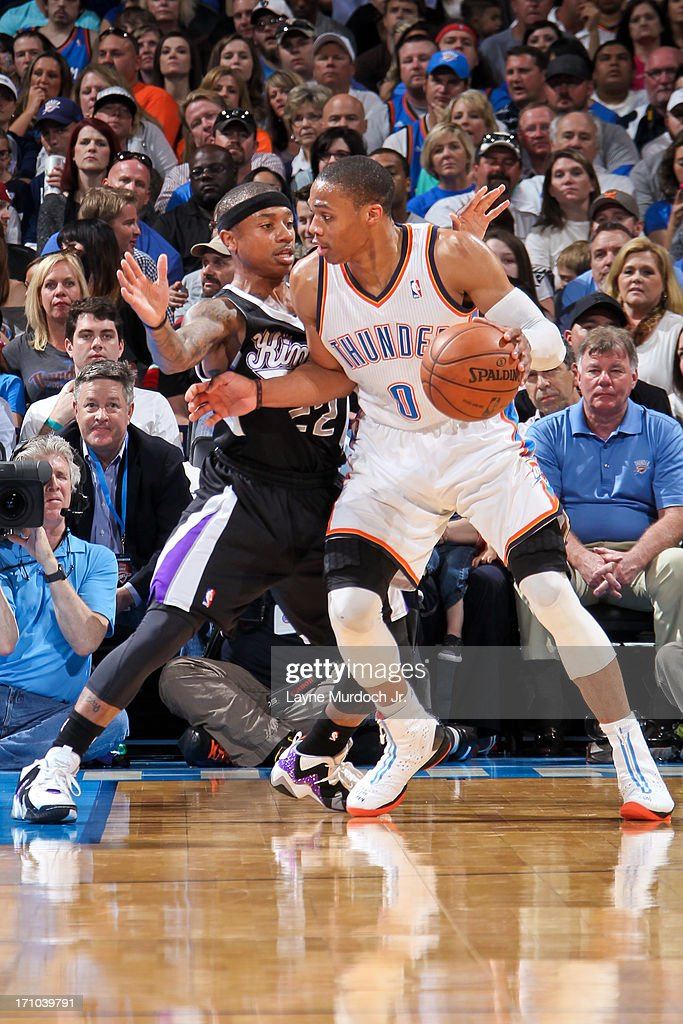 <a gi-track='captionPersonalityLinkClicked' href=/galleries/search?phrase=Russell+Westbrook&family=editorial&specificpeople=4044231 ng-click='$event.stopPropagation()'>Russell Westbrook</a> #0 of the Oklahoma City Thunder drives against Isaiah Thomas #22 of the Sacramento Kings on April 15, 2013 at the Chesapeake Energy Arena in Oklahoma City, Oklahoma.