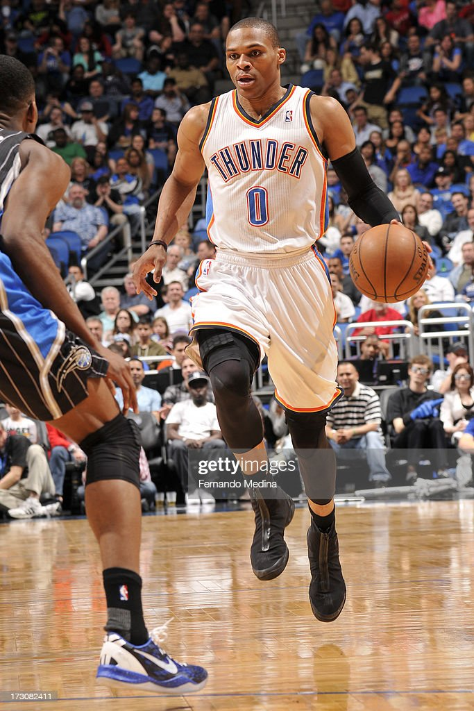 Russell Westbrook #0 of the Oklahoma City Thunder drives against the Orlando Magic on March 22, 2013 at Amway Center in Orlando, Florida.
