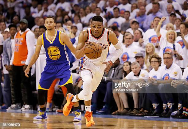 Russell Westbrook of the Oklahoma City Thunder drives against the Golden State Warriors in the third quarter in game four of the Western Conference...