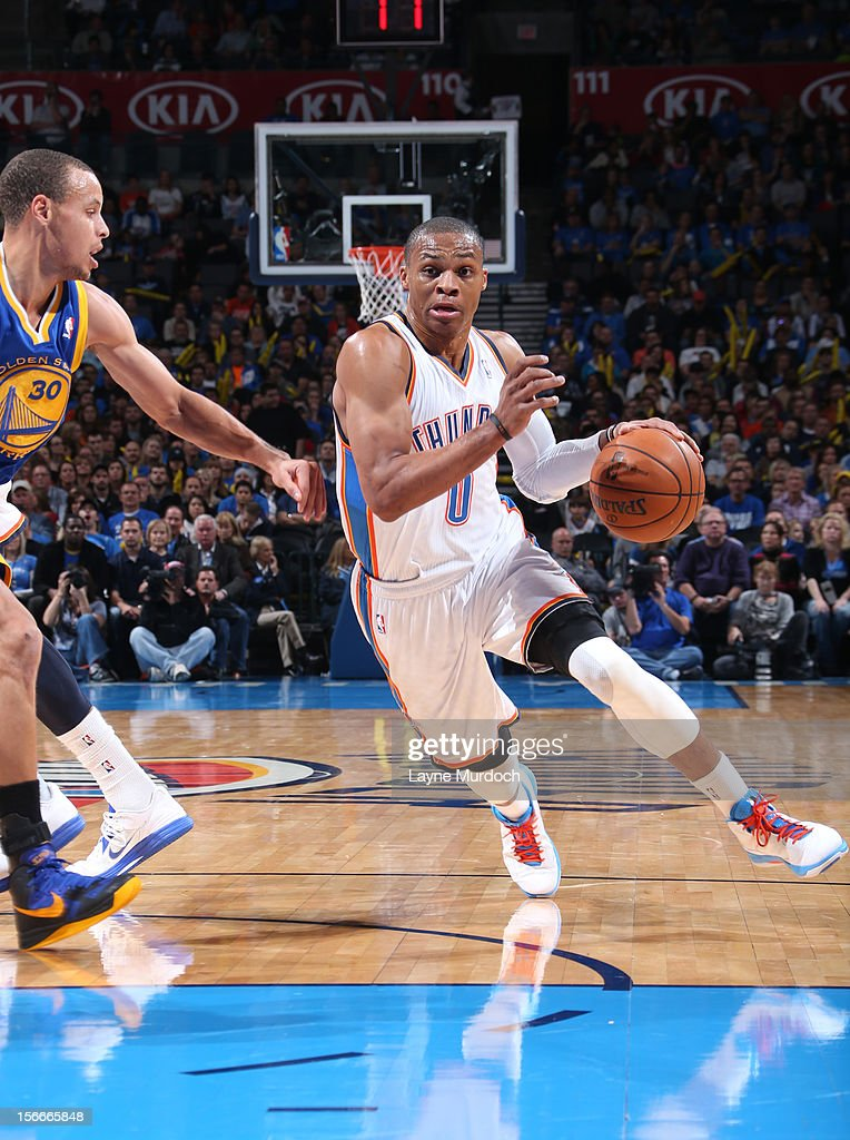 Russell Westbrook #0 of the Oklahoma City Thunder drives during the game between the Oklahoma City Thunder and the Golden State Warriors on November 18, 2012 at the Chesapeake Energy Arena in Oklahoma City, Oklahoma.