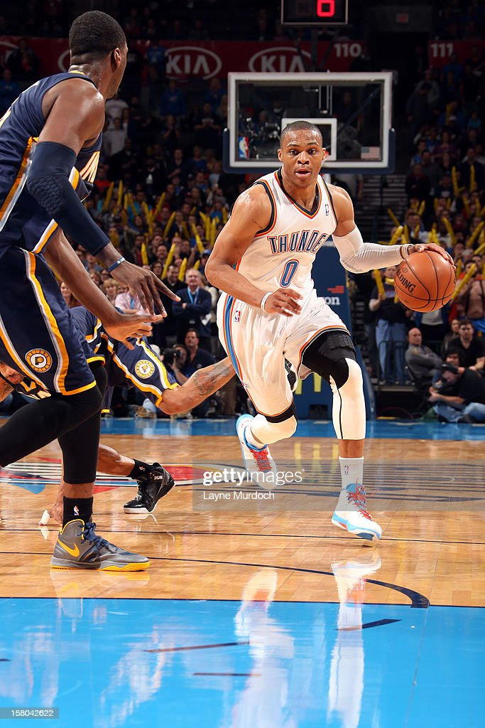 <a gi-track='captionPersonalityLinkClicked' href=/galleries/search?phrase=Russell+Westbrook&family=editorial&specificpeople=4044231 ng-click='$event.stopPropagation()'>Russell Westbrook</a> #0 of the Oklahoma City Thunder drives during the game between the Oklahoma City Thunder and the Indiana Pacers on December 9, 2012 at the Chesapeake Energy Arena in Oklahoma City, Oklahoma.