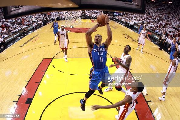 Russell Westbrook of the Oklahoma City Thunder drives for a shot attempt against Norris Cole of the Miami Heat in Game Five of the 2012 NBA Finals on...