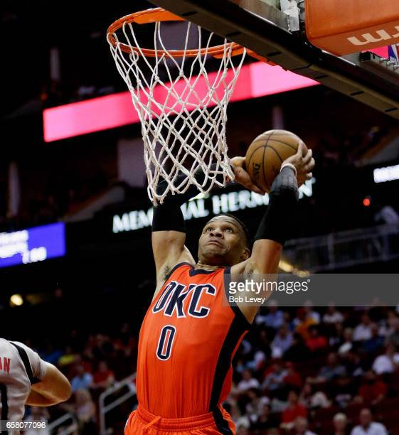 Russell Westbrook of the Oklahoma City Thunder drives for dunk during the fourth quarter against the Houston Rockets at Toyota Center on March 26...
