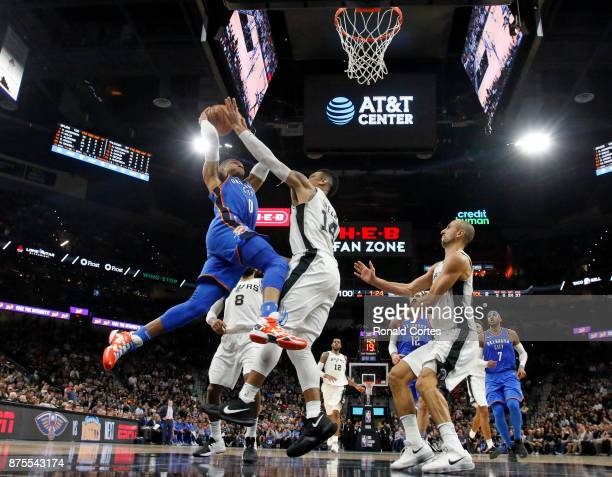 Russell Westbrook of the Oklahoma City Thunder drives for two against Danny Green of the San Antonio Spurs at ATT Center on November 17 2017 in San...