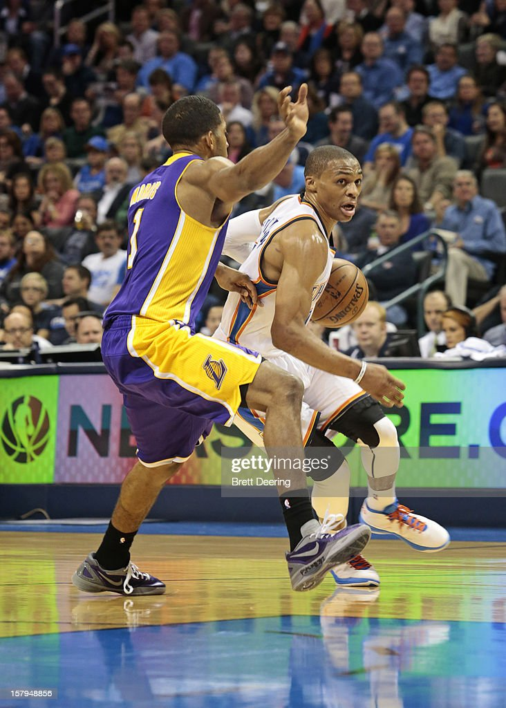 Russell Westbrook #0 of the Oklahoma City Thunder drives on Devin Ebanks #3 of the Los Angeles Lakers December 7, 2012 at Chesapeake Energy Arena in Oklahoma City, Oklahoma. Oklahoma City defeated Los Angeles 114-108.