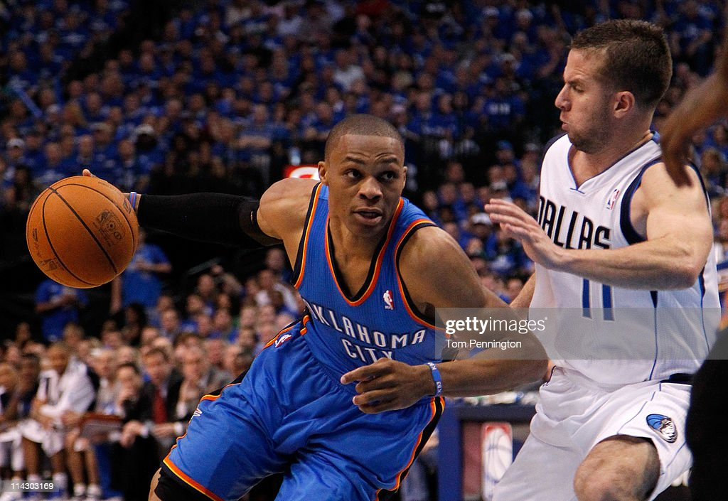 Russell Westbrook #0 of the Oklahoma City Thunder drives on Jose Juan Barea #11 of the Dallas Mavericks in the second quarter in Game One of the Western Conference Finals during the 2011 NBA Playoffs at American Airlines Center on May 17, 2011 in Dallas, Texas.