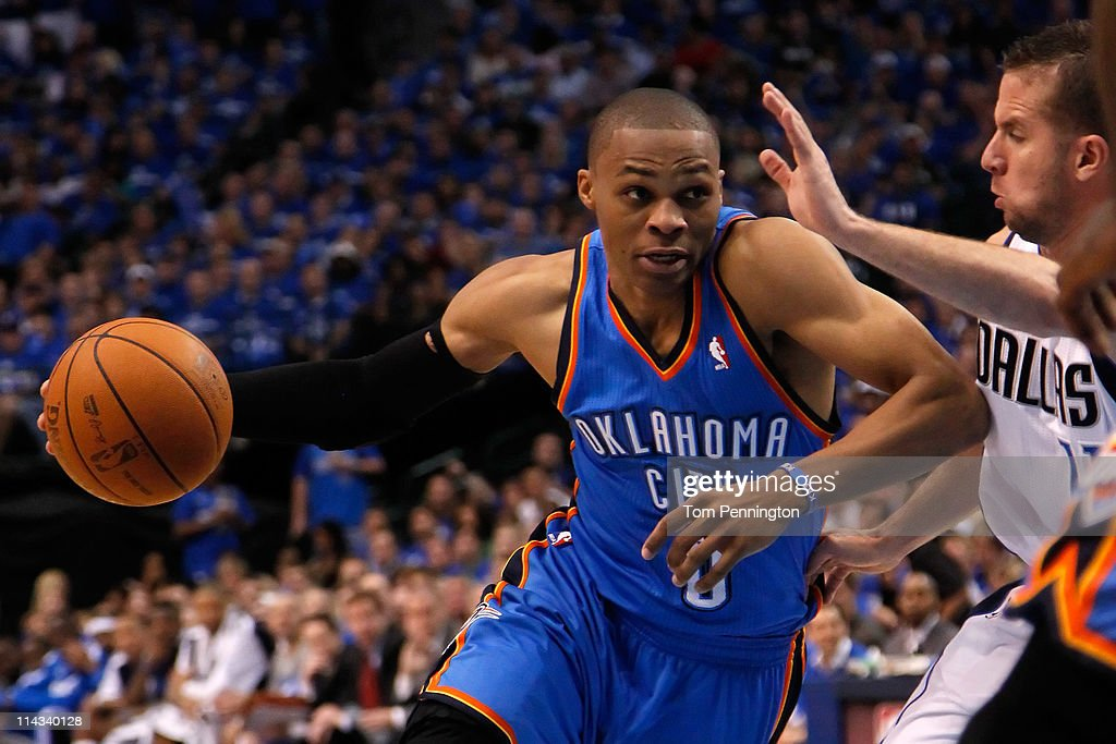 Russell Westbrook #0 of the Oklahoma City Thunder drives on Jose Juan Barea #11 of the Dallas Mavericks in Game One of the Western Conference Finals during the 2011 NBA Playoffs at American Airlines Center on May 17, 2011 in Dallas, Texas.