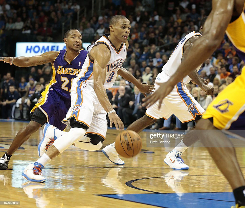 <a gi-track='captionPersonalityLinkClicked' href=/galleries/search?phrase=Russell+Westbrook&family=editorial&specificpeople=4044231 ng-click='$event.stopPropagation()'>Russell Westbrook</a> #0 of the Oklahoma City Thunder drives past <a gi-track='captionPersonalityLinkClicked' href=/galleries/search?phrase=Chris+Duhon&family=editorial&specificpeople=202879 ng-click='$event.stopPropagation()'>Chris Duhon</a> #21 of the Los Angeles Lakers December 7, 2012 at Chesapeake Energy Arena in Oklahoma City, Oklahoma. Oklahoma City defeated Los Angeles 114-108.