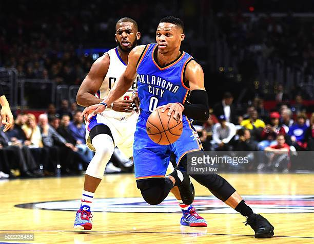 Russell Westbrook of the Oklahoma City Thunder drives past Chris Paul of the Los Angeles Clippers during the first half at Staples Center on December...