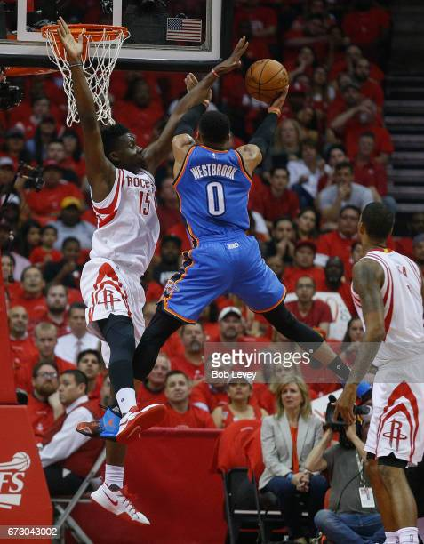 Russell Westbrook of the Oklahoma City Thunder drives past Clint Capela of the Houston Rockets and Trevor Ariza for a layup during Game Five of the...