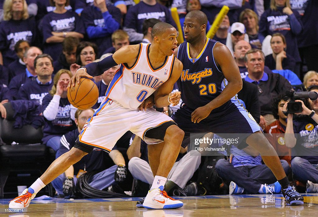 <a gi-track='captionPersonalityLinkClicked' href=/galleries/search?phrase=Russell+Westbrook&family=editorial&specificpeople=4044231 ng-click='$event.stopPropagation()'>Russell Westbrook</a> #0 of the Oklahoma City Thunder drives to the basket against <a gi-track='captionPersonalityLinkClicked' href=/galleries/search?phrase=Raymond+Felton&family=editorial&specificpeople=209141 ng-click='$event.stopPropagation()'>Raymond Felton</a> #20 of the Denver Nuggets in Game Five of the Western Conference Quarterfinals in the 2011 NBA Playoffs on April 27, 2011 at the Ford Center in Oklahoma City, Oklahoma.