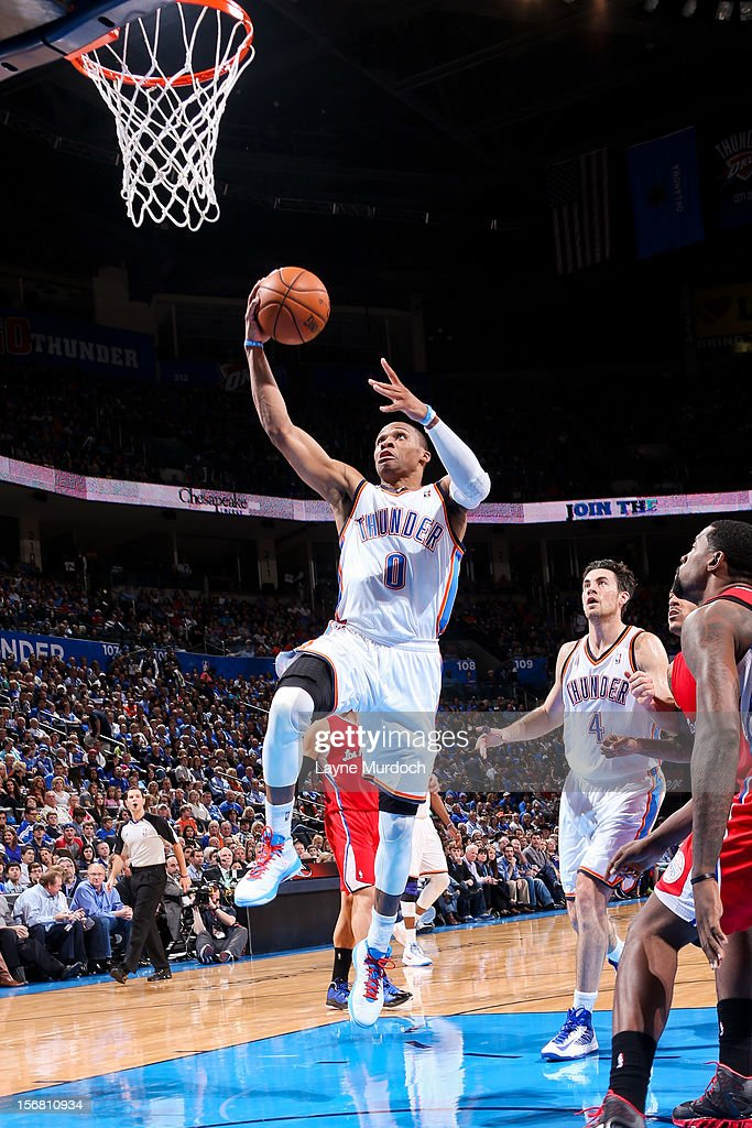Russell Westbrook #0 of the Oklahoma City Thunder drives to the basket against the Los Angeles Clippers on November 21, 2012 at the Chesapeake Energy Arena in Oklahoma City, Oklahoma.