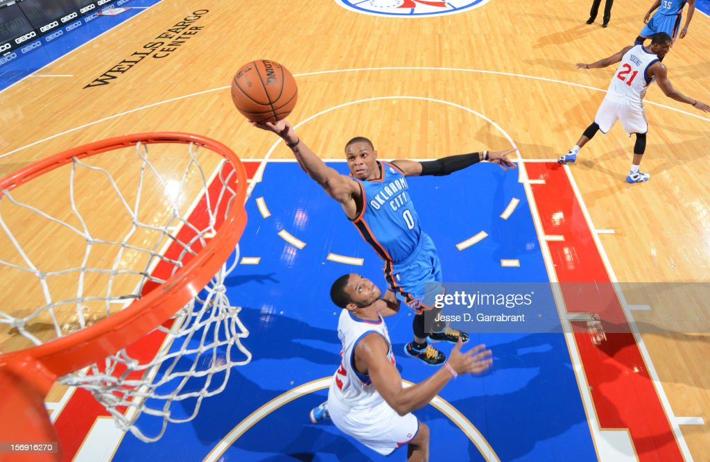 Russell Westbrook #0 of the Oklahoma City Thunder drives to the basket the Philadelphia 76ers during the game at the Wells Fargo Center on November 24, 2012 in Philadelphia, Pennsylvania.