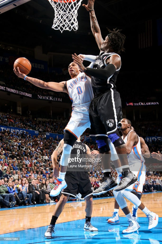 Russell Westbrook #0 of the Oklahoma City Thunder drives to the basket against Gerald Wallace #45 of the Brooklyn Nets on January 2, 2013 at the Chesapeake Energy Arena in Oklahoma City, Oklahoma.