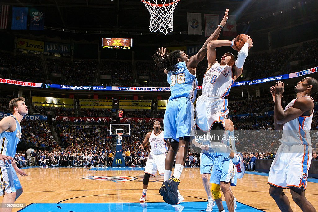 Russell Westbrook #0 of the Oklahoma City Thunder drives to the basket against Kenneth Faried #35 of the Denver Nuggets on January 16, 2013 at the Chesapeake Energy Arena in Oklahoma City, Oklahoma.