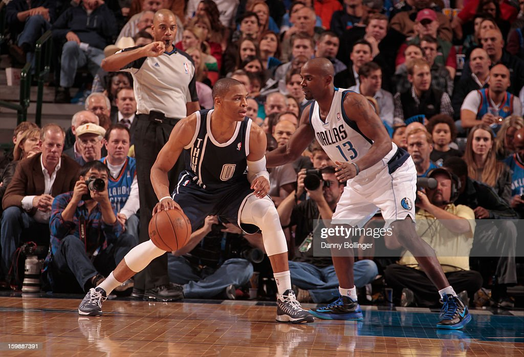 Russell Westbrook #0 of the Oklahoma City Thunder drives to the basket against Mike James #13 of the Dallas Mavericks on January 18, 2013 at the American Airlines Center in Dallas, Texas.