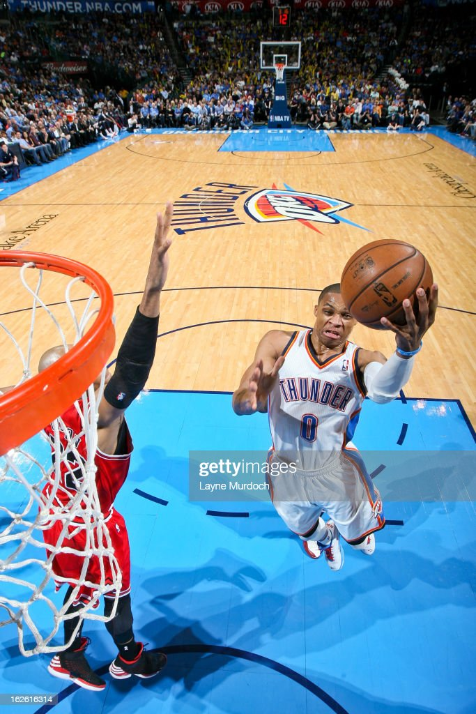 <a gi-track='captionPersonalityLinkClicked' href=/galleries/search?phrase=Russell+Westbrook&family=editorial&specificpeople=4044231 ng-click='$event.stopPropagation()'>Russell Westbrook</a> #0 of the Oklahoma City Thunder drives to the basket against <a gi-track='captionPersonalityLinkClicked' href=/galleries/search?phrase=Taj+Gibson&family=editorial&specificpeople=4029461 ng-click='$event.stopPropagation()'>Taj Gibson</a> #22 of the Chicago Bulls on February 24, 2013 at the Chesapeake Energy Arena in Oklahoma City, Oklahoma.