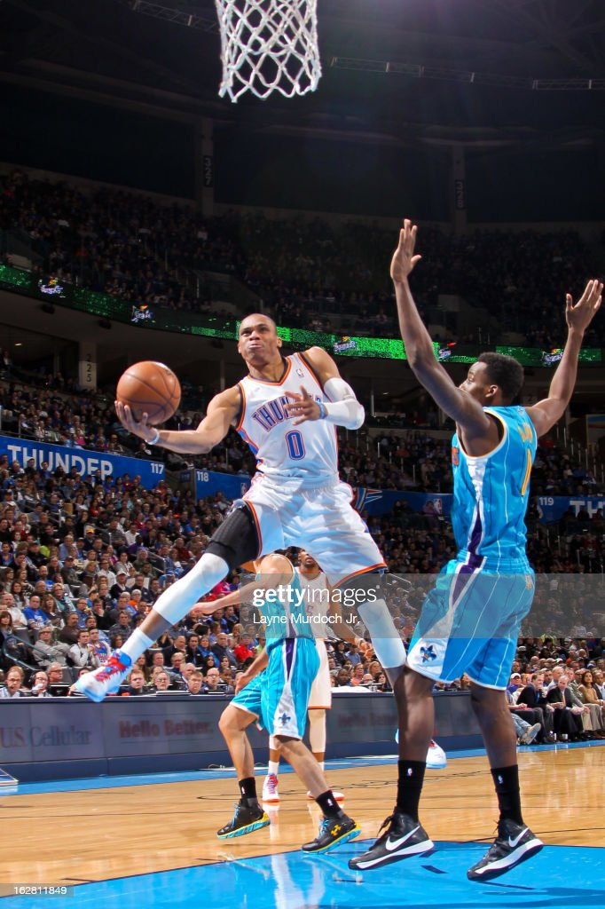Russell Westbrook #0 of the Oklahoma City Thunder drives to the basket against Al-Farouq Aminu #0 of the New Orleans Hornets on February 27, 2013 at the Chesapeake Energy Arena in Oklahoma City, Oklahoma.