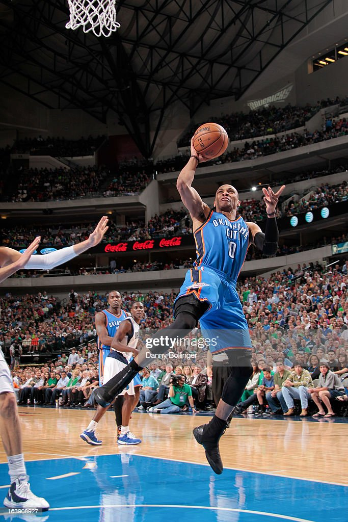 Russell Westbrook #0 of the Oklahoma City Thunder drives to the basket against the Dallas Mavericks on March 17, 2013 at the American Airlines Center in Dallas, Texas.