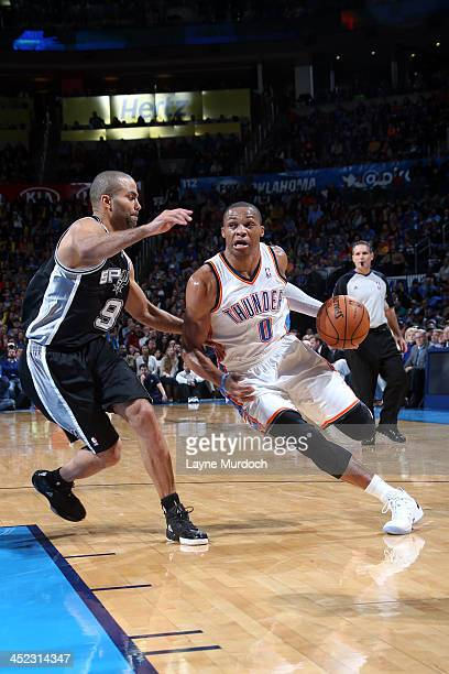 Russell Westbrook of the Oklahoma City Thunder drives to the basket against Tony Parker of the San Antonio Spurs on November 27 2013 at the...