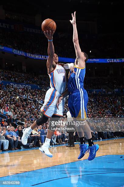 Russell Westbrook of the Oklahoma City Thunder drives to the basket tate Warriors on November 29 2013 at the Chesapeake Energy Arena in Oklahoma City...